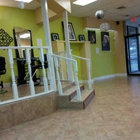 Photo taken at D's Dominican Hair Salon by Meshia F. on 7/13/2013