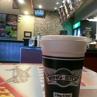 Photo taken at Wingstop by Ron W. on 12/21/2012