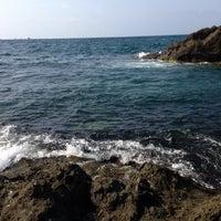 Photo taken at Kayalık Beach by Seyhan Ö. on 8/12/2013