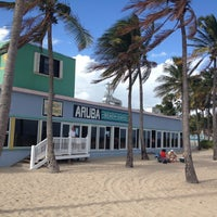 Photo taken at Aruba Beach Cafe by Aida on 11/18/2012