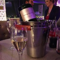 Photo taken at Laurent Perrier Champagne Bar by Zoe C. on 3/25/2016