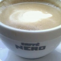 Photo taken at Caffè Nero by E R B A Y on 9/14/2012