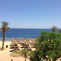 Photo taken at Beach at Reef Oasis Blue Bay Resort by RL . on 6/18/2013