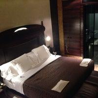 Photo taken at Hotel Bagués by Byron S. on 11/8/2013
