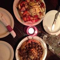 Photo taken at Iguana Café by Nadia A. on 5/21/2013