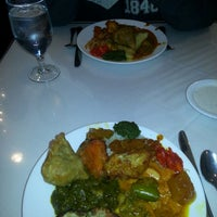 Photo taken at Shalimar Indian Restaurant by Mark W. on 1/4/2014