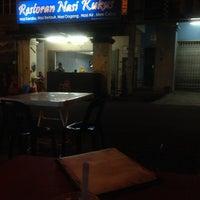 Photo taken at Restoran Nasi Kukus by Azizi B. on 4/3/2014