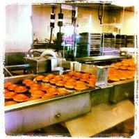 Photo taken at Krispy Kreme Doughnuts by Vernon H. on 5/25/2013