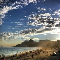 Photo taken at Ipanema Beach by Marcelo B. on 7/13/2013