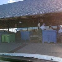 Photo taken at Oistins Fish Market by Fabien B. on 12/15/2012