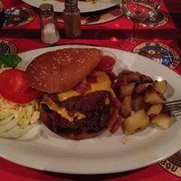 Photo taken at Le Caribou Café by Fryar on 11/30/2013