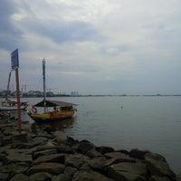 Photo taken at Pantai Indah by Andi M. on 1/13/2015