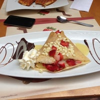 Photo taken at Crepes & Waffles by Daniela T. on 12/17/2012
