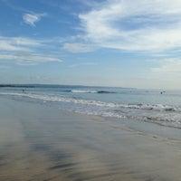 Photo taken at Legian Beach by Julia P. on 3/18/2013