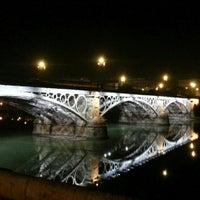 Photo taken at Isabel II Bridge 'Triana Bridge' by Armando Enrique D. on 1/11/2013