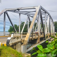 Photo taken at Agus Bridge by Justin Q. on 12/21/2013