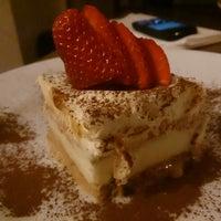 Photo taken at Malina Restaurant by Adam P. on 4/1/2013