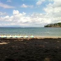 Photo taken at Pantai Senggigi by Rony K. on 2/10/2013