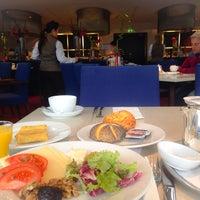 Photo taken at Restaurant Flavors by Ebru E. on 5/7/2014