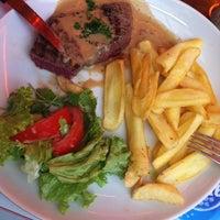 Photo taken at Biclowne Café by Juliana C. on 9/30/2013