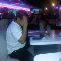 Photo taken at Blue Ribbon Bar & Grill by Paul X. on 4/25/2014