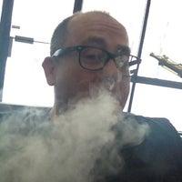 Photo taken at Smokeless Smoking Vapor Lounge by Chris on 2/10/2013