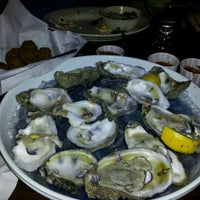 Photo taken at Flying Fish by JULIE T. on 12/1/2012