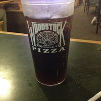 Photo taken at Woodstock's Pizza by Erin B. on 9/21/2013