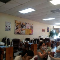Photo taken at Famous Nails by Liz C. on 6/17/2013