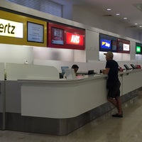 Photo taken at Hertz Desk, International Terminal by Виктория on 1/7/2016