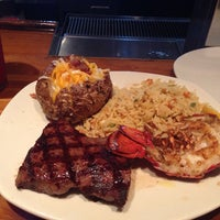 Photo taken at Outback Steakhouse by Tré D. on 7/31/2014