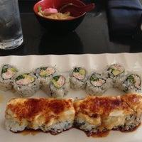 Photo taken at Tomodachi Sushi by Kacie S. on 3/21/2013