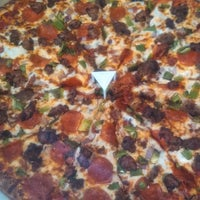 Photo taken at 21st Century Pizza by Brandon R. on 2/2/2014