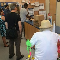 Photo taken at Downtown Post Office by graceface k. on 7/10/2014