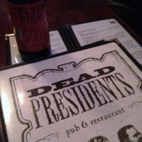 Photo taken at Dead Presidents Pub & Restaurant by Laura A. on 3/15/2013