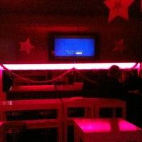 Photo taken at Warm Up Karaoke by Derya E. on 12/30/2012