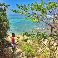 Photo taken at Bali Cliff Beach by Zainul H. on 9/1/2015