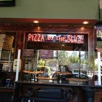 Photo taken at Schmizza Pub & Grub by Ben D. on 8/20/2013