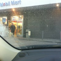 Photo taken at Mobil by Cinthya on 1/27/2013