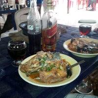 Photo taken at NPA Quatars Cat fish pepper soup joint by Osajiele O. on 8/25/2013