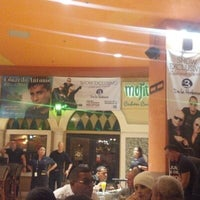 Photo taken at Mojitos Cuban Restaurant by Raidel A. on 12/1/2012