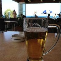 Photo taken at Ariadne Beach Bar by Ivan B. on 8/12/2013