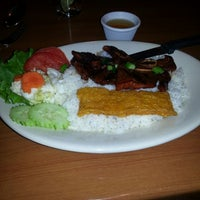 Photo taken at Miss Saigon Vietnamese Cuisine by Stacey M. on 3/3/2013
