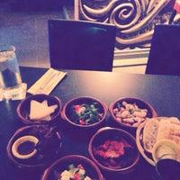 Photo taken at Ritmo Tapas Bar Restaurant by Egem S. on 9/4/2013