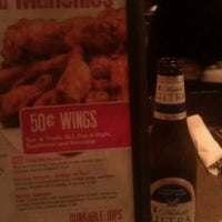 Photo taken at Brann's Sports Grille by Christie H. on 9/15/2012