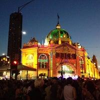 Photo taken at Flinders Street Station by Erik C. on 2/23/2013