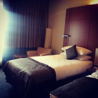 Photo taken at Radisson Blu Water Garden Hotel by Precious on 5/5/2013