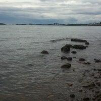 Photo taken at Pantai Saujana (Pantai Batu Empat) by Mafiz M. on 12/25/2012