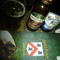 Photo taken at Mulligan Irish Pub by Luís Gustavo B. on 7/15/2012