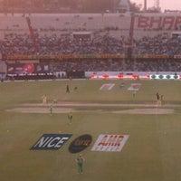 Photo taken at Rajiv Gandhi Cricket Stadium by Maheshwar M. on 1/21/2012